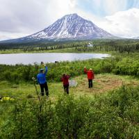 hikers admire the sacred mountain in Naats'ihch'oh National Park Reserve